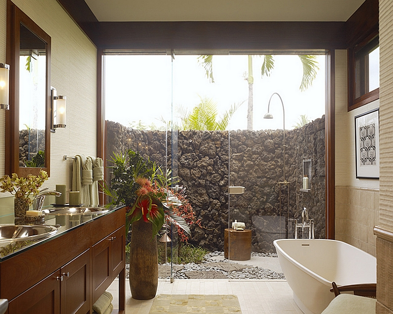 Extend the indoor bathroom outside with a glass wall shower area [Design: Slifer Designs]
