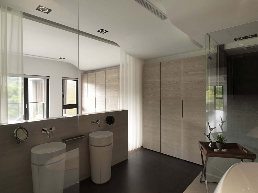Extensive use of soft wood tones in the contemporary bath