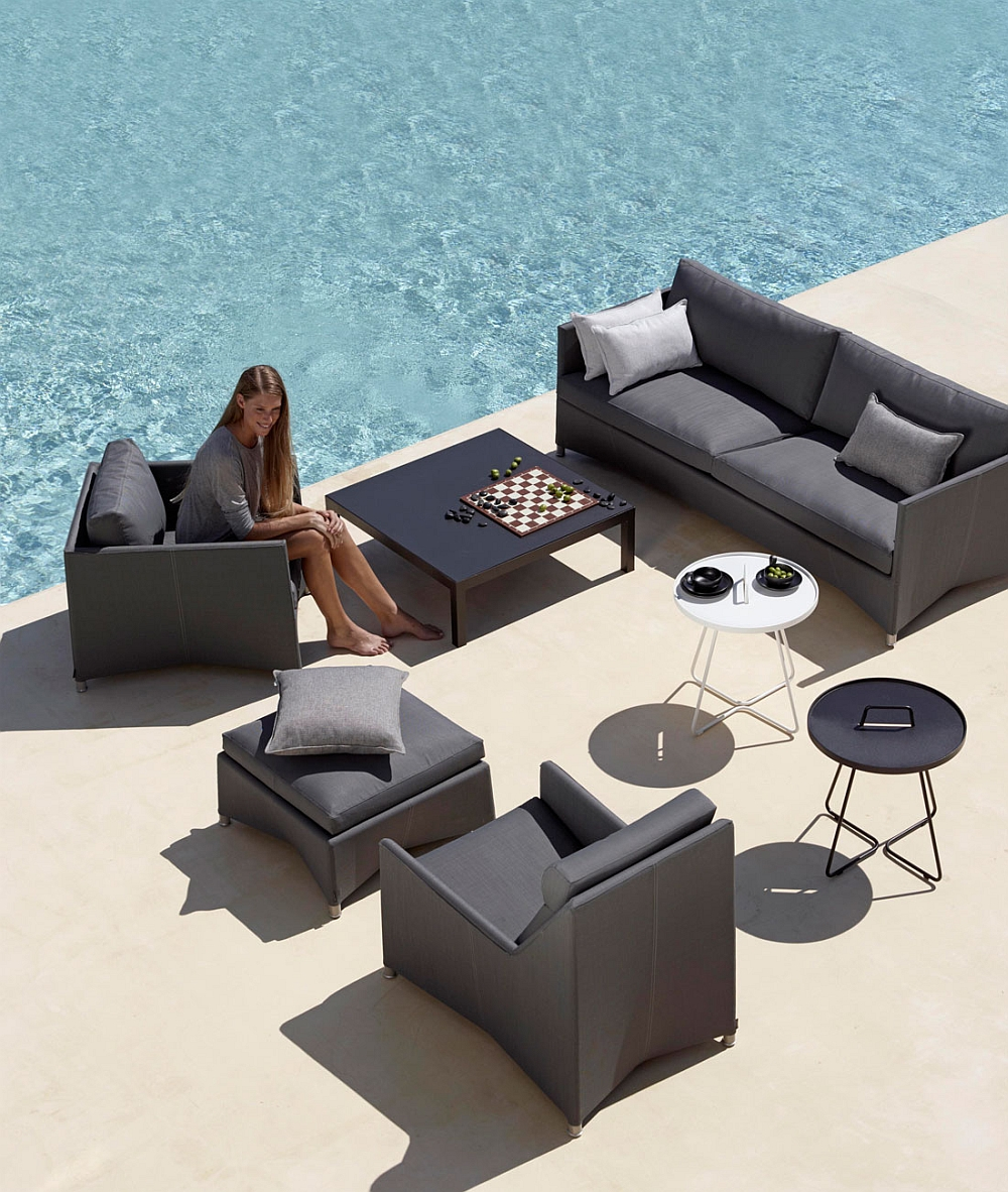 Fashionable outdoor chairs and couch in trendy grey