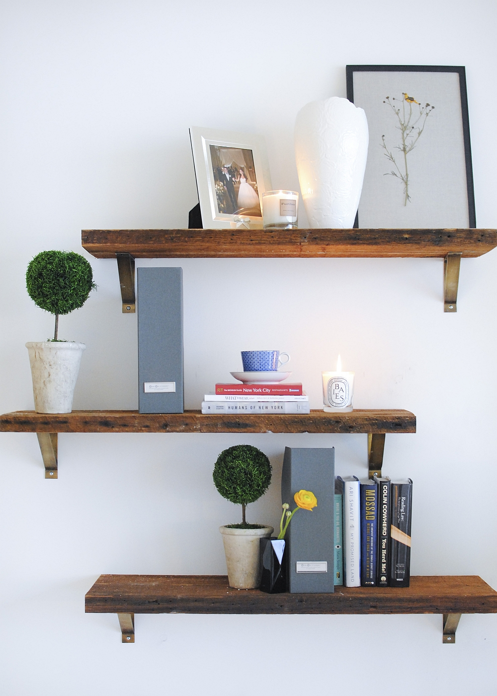 Floating wooden shelves inside the contemporary home