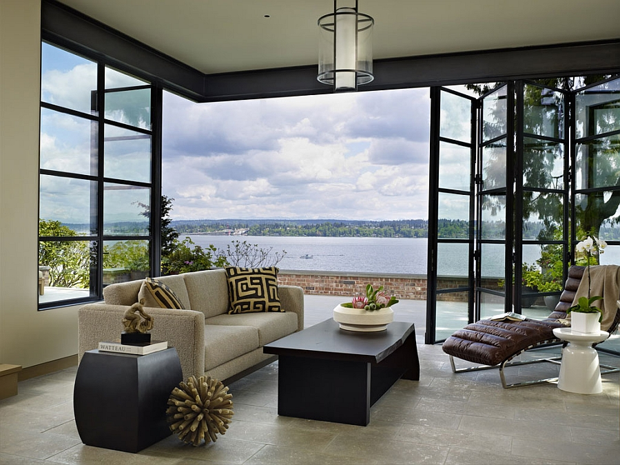 Floor to ceiling floding glass doors with stainless steel frame Classic Seattle Lakefront House gets a Bookish Modern Twist!