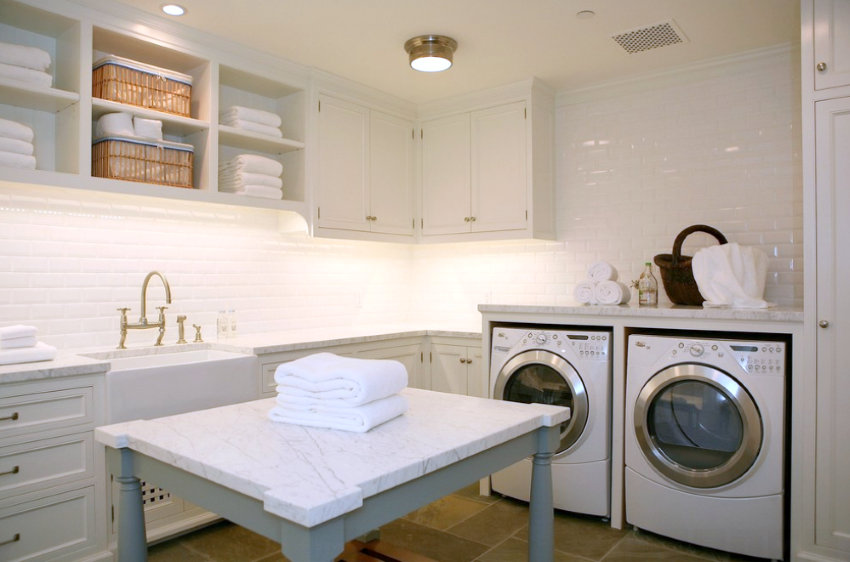 Folded white towels in a laundry room