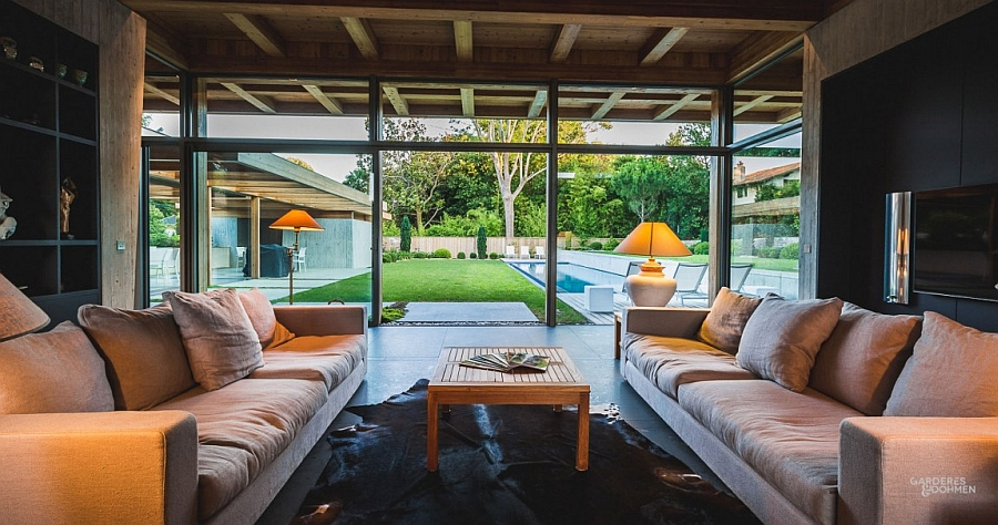 Glass doors and windows connect the living area with the backyard