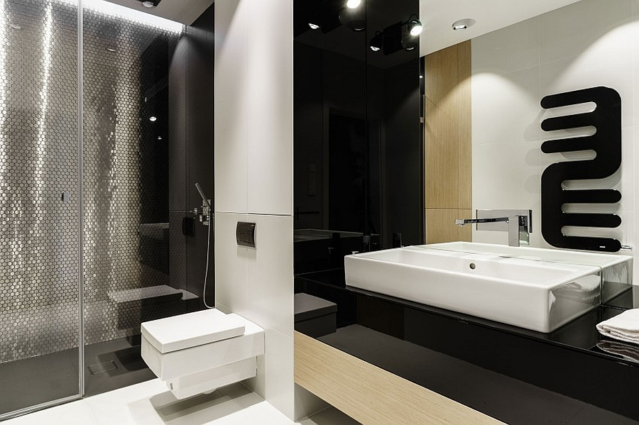 Glittering tiles of the shower area give the bathroom an airy appeal