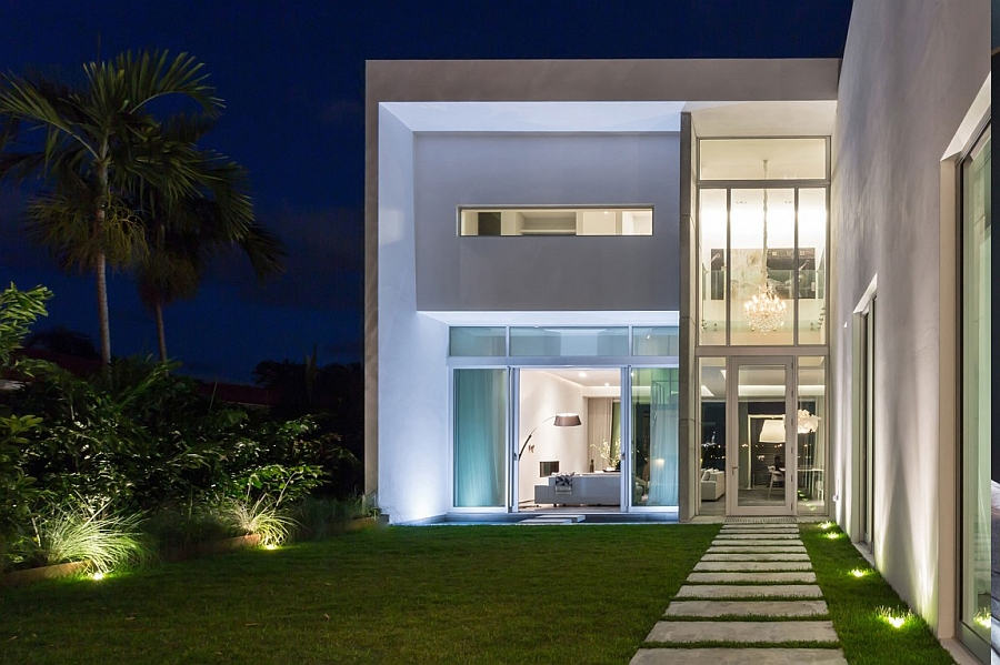 Gorgeous lighting takes over the posh beach house after sunset