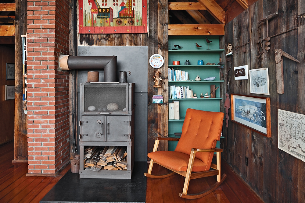 Gorgeous rocking chair next to the fireplace