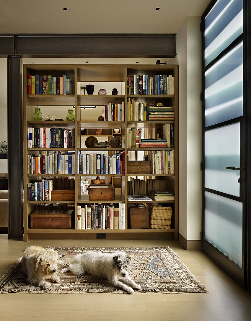 Gorgeous way to delineate spaces using bookshelves