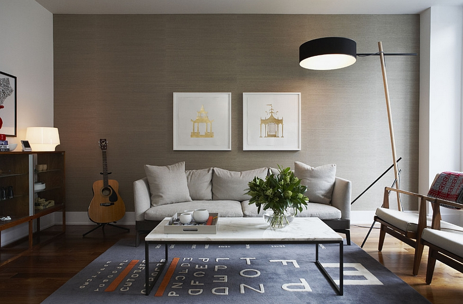 Grasscloth backdrop lets the framed artwork standout beautifully [Design: Croma Design]