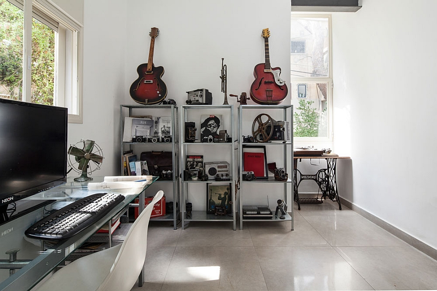 Home workspace with a collection of musical instruments