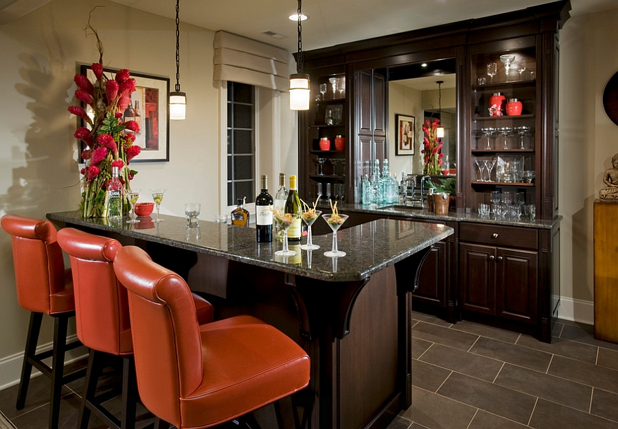 Interesting use of pops of orange in the basement [Design: Guidi Homes]