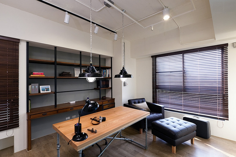 lighting adds an industrial touch to the home office design pmk
