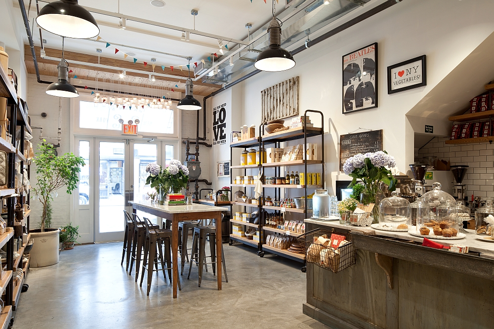 garage hangout ideas - Old NYC Carriage House Renovated Into A Trendy Café