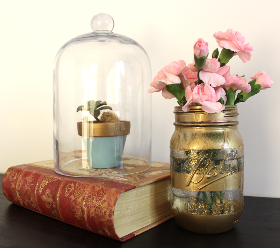 Mason Jar in Gold and Terrarium used as decorative pieces