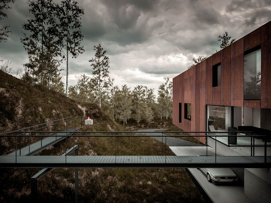 Metalic walkway leading to the house makes for an amazing entrance Dramatic Minimalist Home Transforms an Abandoned Quarry in the UK