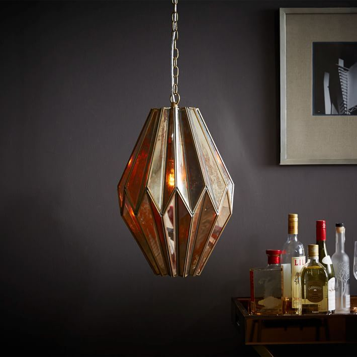 Mirrored brassy pendant light