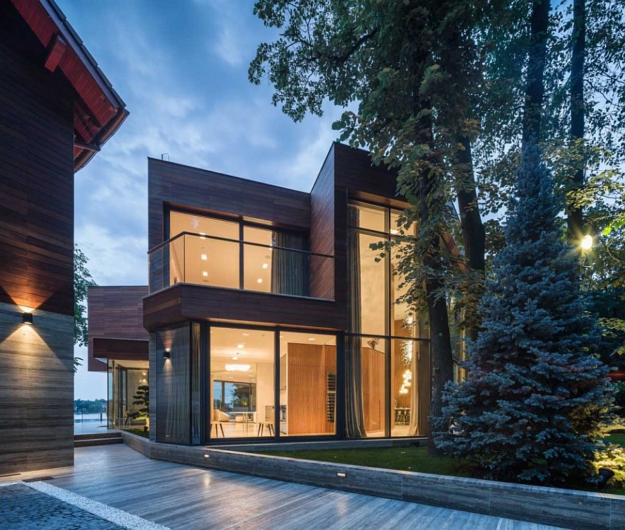 Modern Forest House: Radiant Romanian Villa Offers Expansive Lake & Forest Views