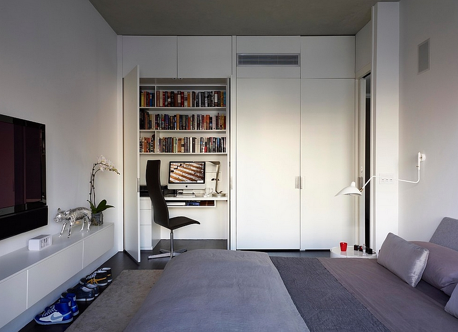 Modern bedroom in New York with a simple home office [Design: West Chin Architects]
