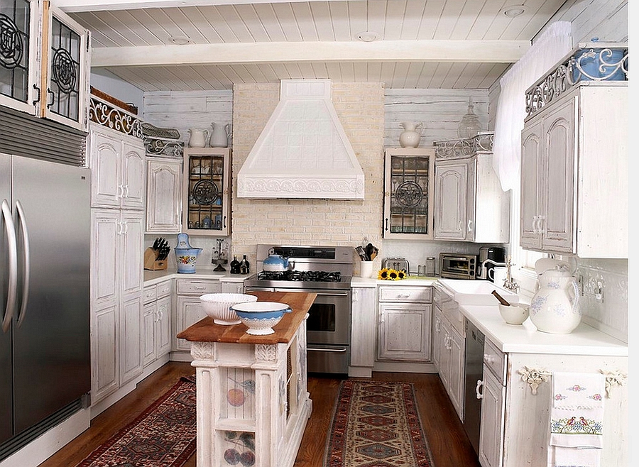 Narrow kitchen in white with a gorgeous island at its heart [Design: Tran + Thomas Design Studio]