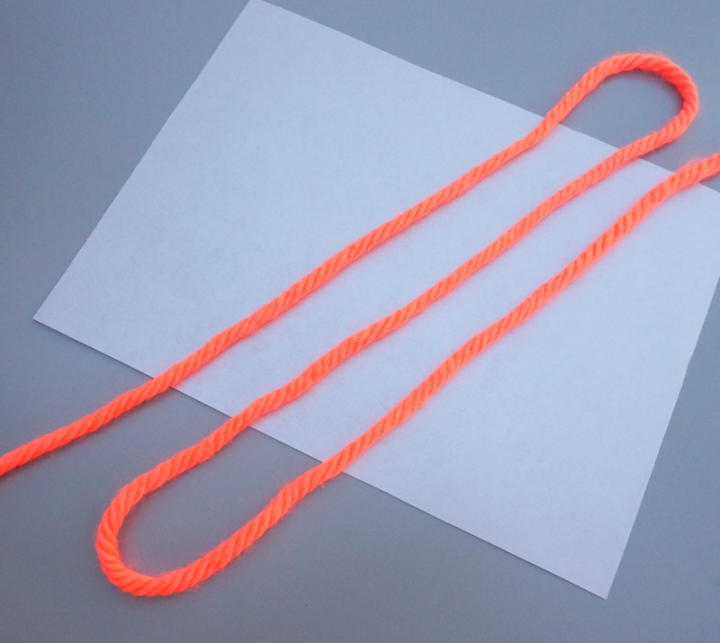 Neon orange yarn adds a bright touch