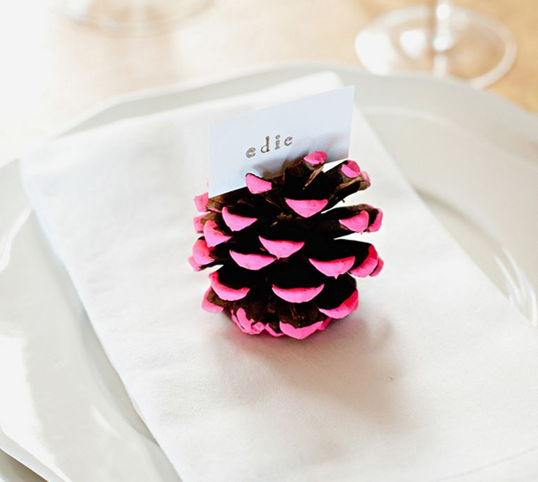 Neon pine cone placecard holder from Camille Styles
