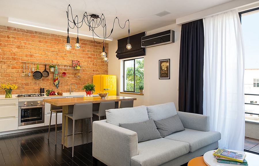 Original brick wall in the modern kitchen and a trendy living space