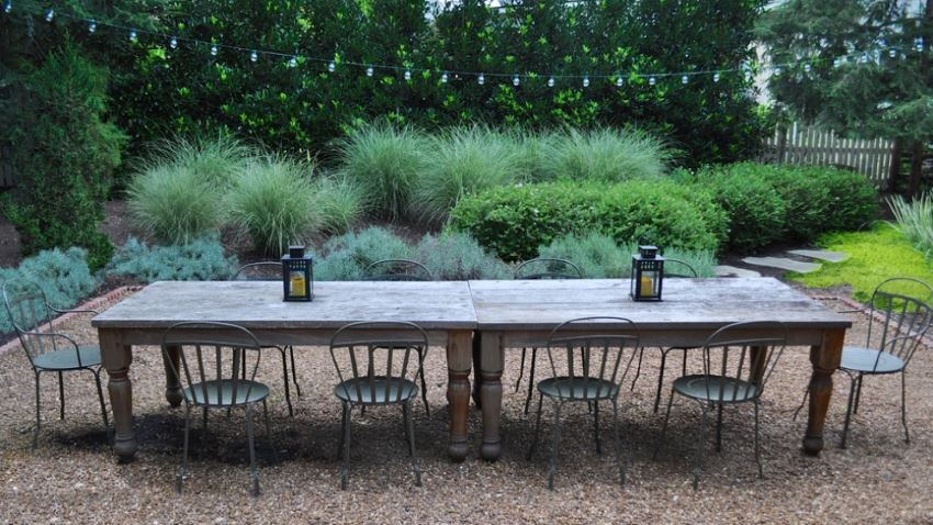 Outdoor dining space surrounded by lush greenery