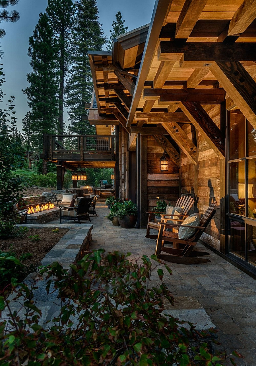 Outdoor lounge and fireplace for the beuatiful winter cabin house