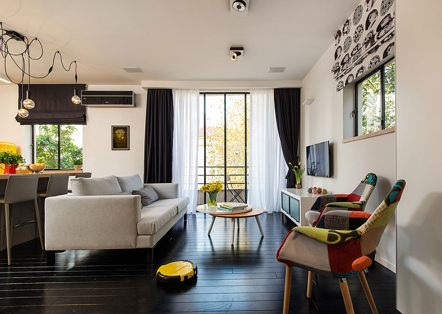 Painted black floor gives the small living room a sophisticated appeal