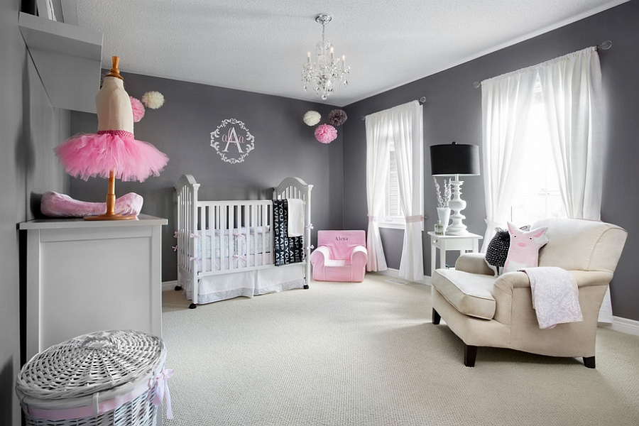Pops of pink add a feminine touch to the posh nursery [From: Lisa Petrole Photography]