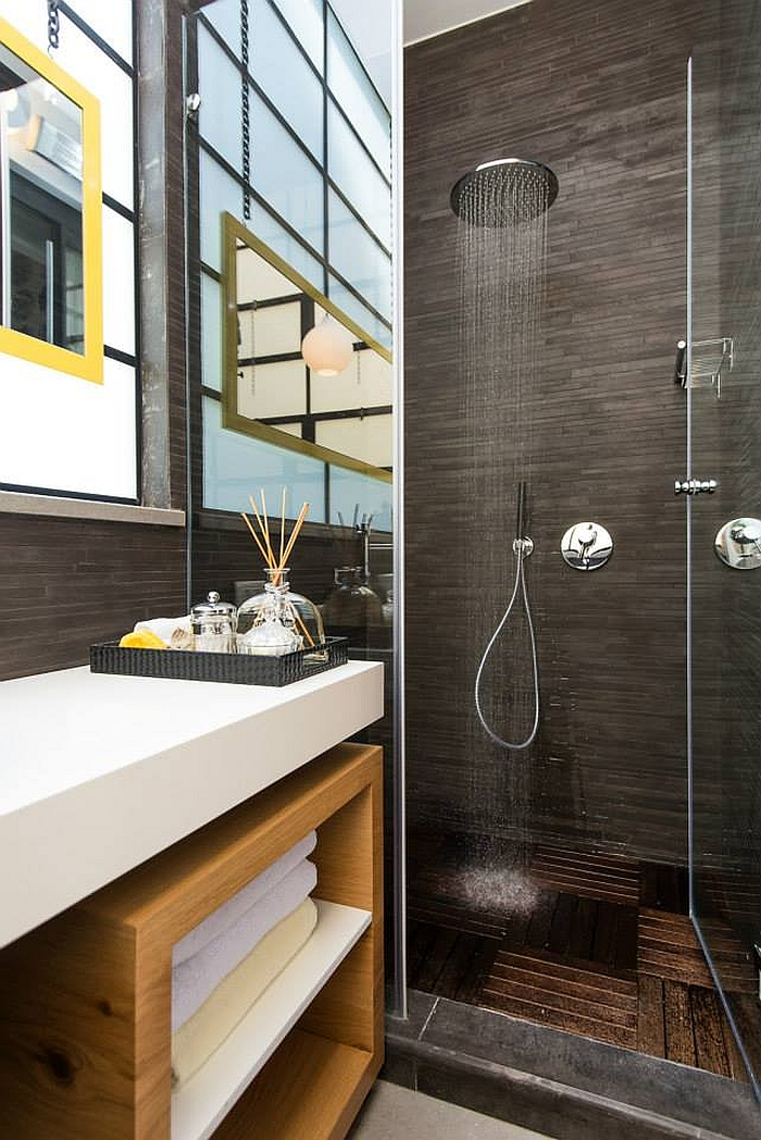 Posh, small bathroom with smart shower area