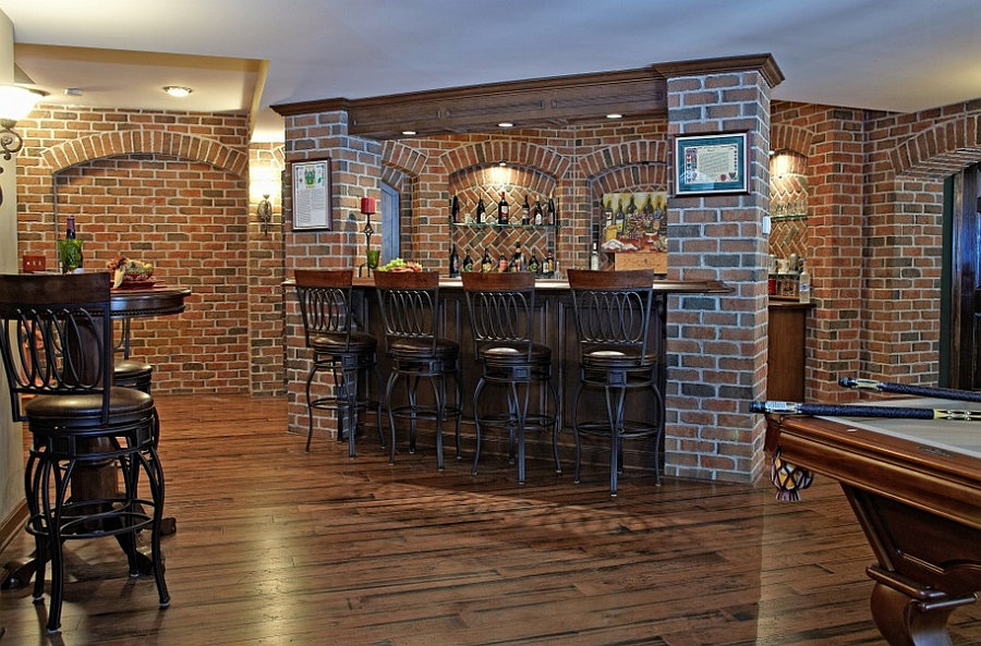 Pub style basement bar with a beautiful brick backdrop [Design: M.J. Whelan Construction]