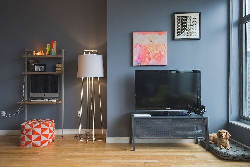 Simple art work and colorful ottoman for the living room