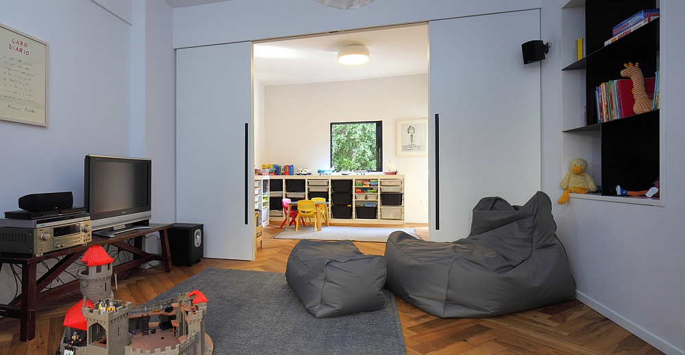 Simple family room that is connected with the children's playroom