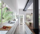 Sleek kitchen and dining space with an airy appeal