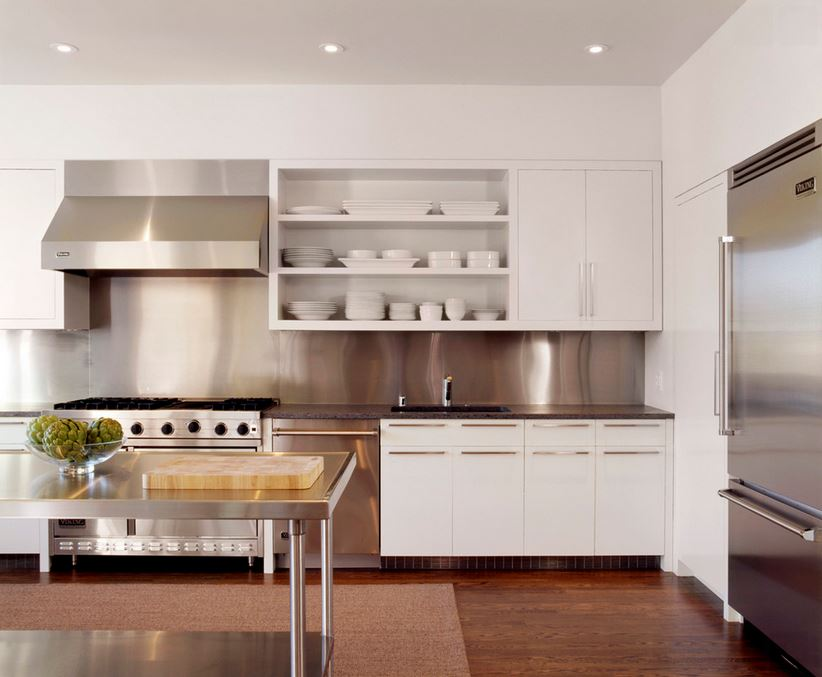 Sleek white dishes on open shelving in a white kitchen 10 Sparkling Kitchens with Open Shelving