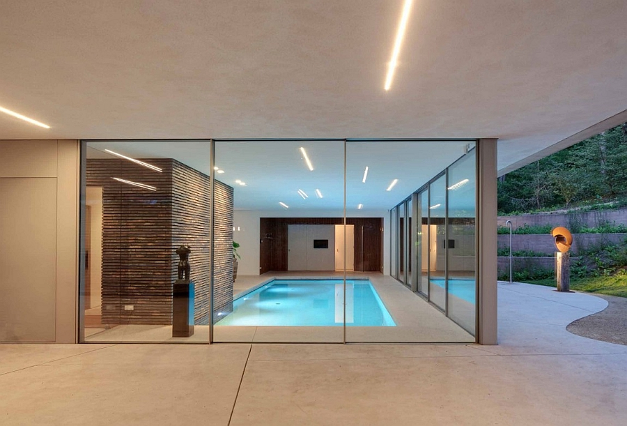 Sliding glass doors connect the pool with the outdoors