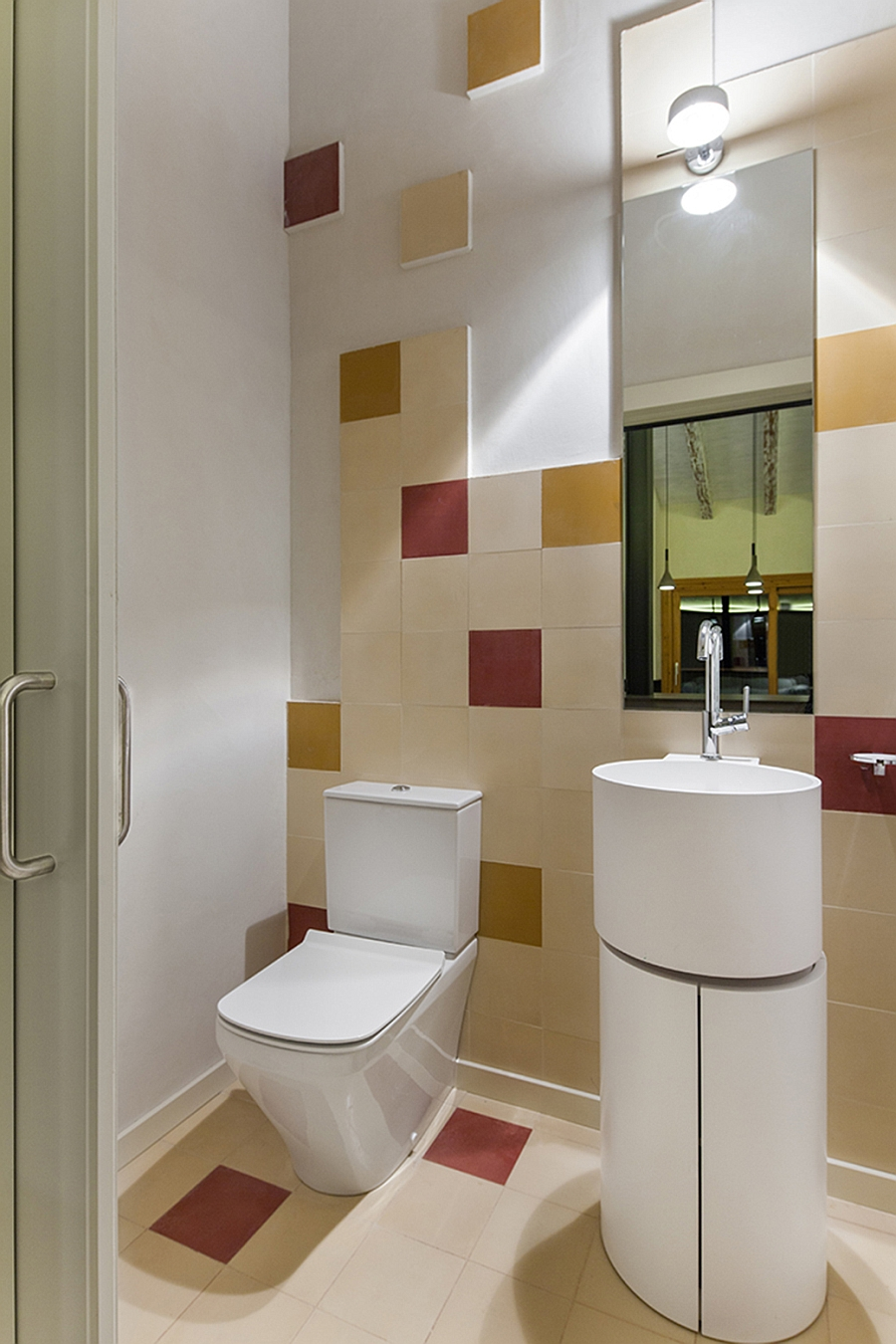 Small bathroom with fun use of red and yellow tiles