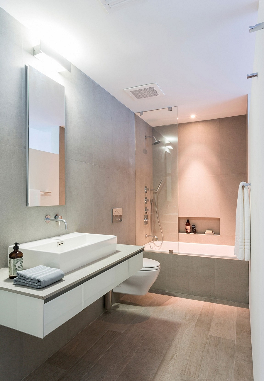 Small shower area and bathroom design in gray and white