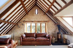 Snug attic living room of a renovated old barn [Design: Hart Design And Construction]
