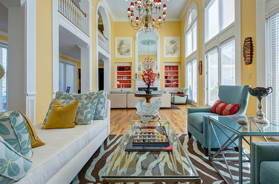 Spacious living room in yellow and blue with a hint of orange [Design: S&K Interiors]