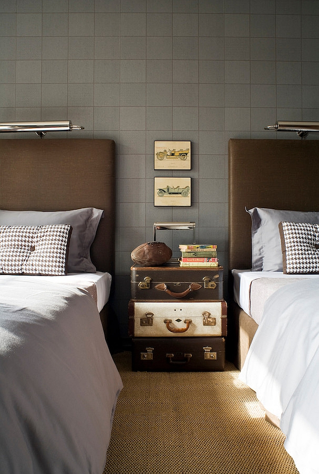 Stacked vintage suitcases used as nightstand in the traditional bedroom