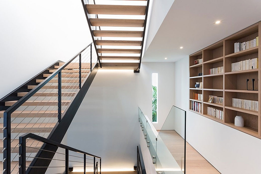 Staircase in steel and wood connects the different levels of the posh beach house