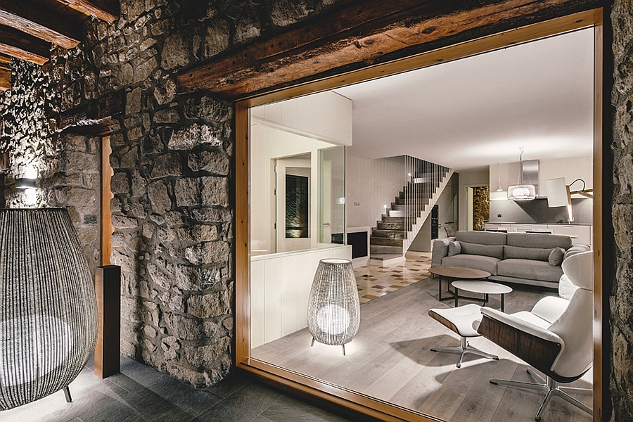 Stylish interior of the restored rustic home with the Eames Lounger