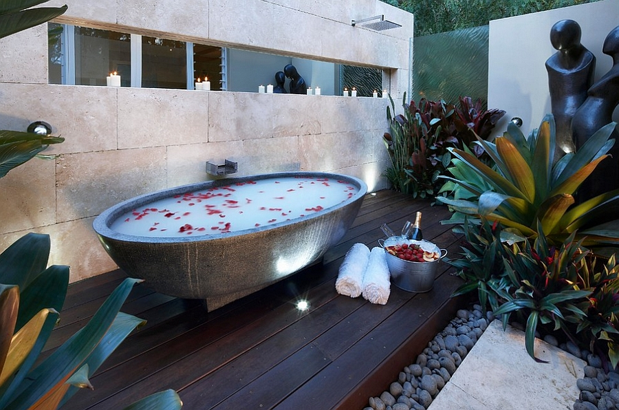 Take the bathtub into the private yard for a serene dip 23 Amazing Inspirations that Take the Bathroom Outdoors!