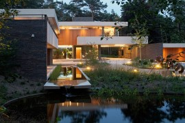 Tranquil reflection pond and brilliant lighting at the villa