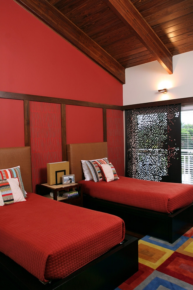 Trendy modern bedroom with a generous splattering of red [Design: B Pila Design Studio]