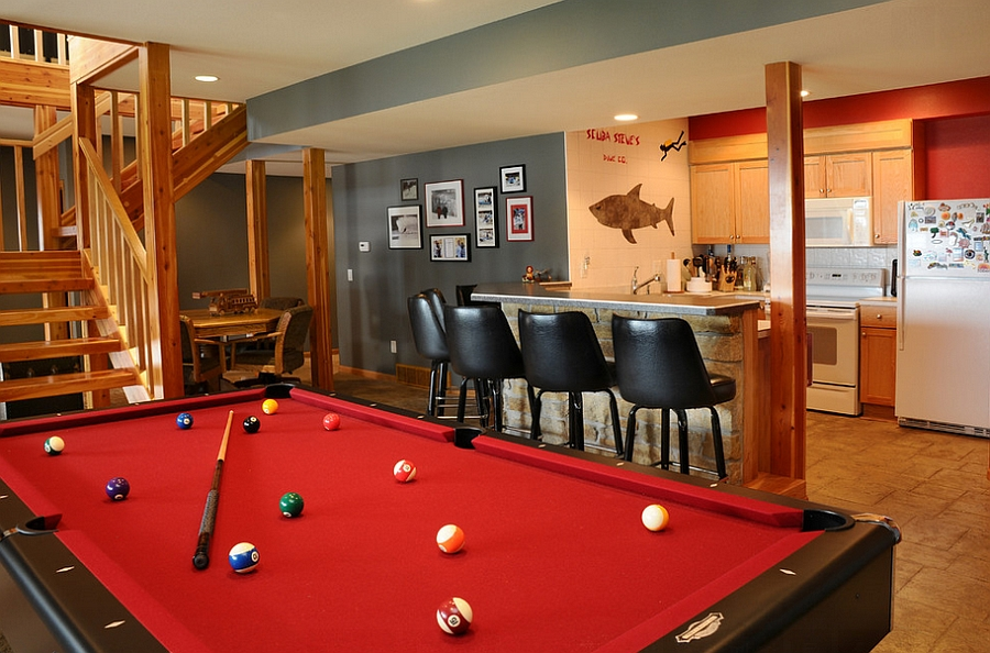 Trendy use of gray and red in the stylish basement bar [Design: JG Development]