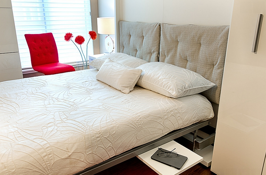 Unravel the bed by tucking away the home office at night [Design: For Space Sake]
