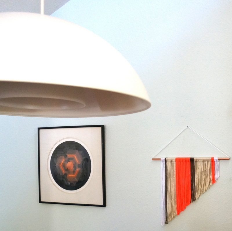 Wall hanging in a modern dining room