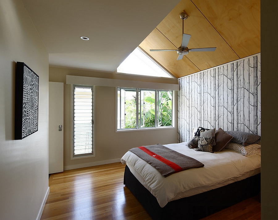 Wallpaper gives the airy bedroom an instant focal point